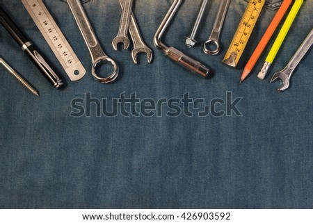 Wrench tools on a denim workers, A jeans with engineer tools. - stock photo