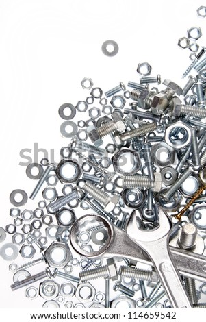 Wrenches, nuts and bolts on plain background - stock photo