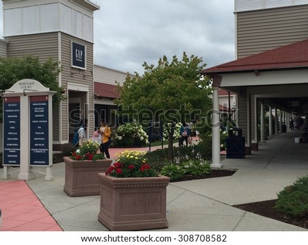 WRENTHAM, MA - JUL 18: Wrentham Village Premium Outlets in Massachusetts, as seen on July 18, 2015. It is spread over 616,000 sq ft and houses 170 retailers.