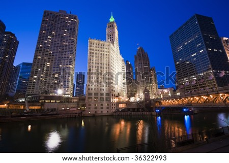 Wrigley Building by Chicago River. - stock photo