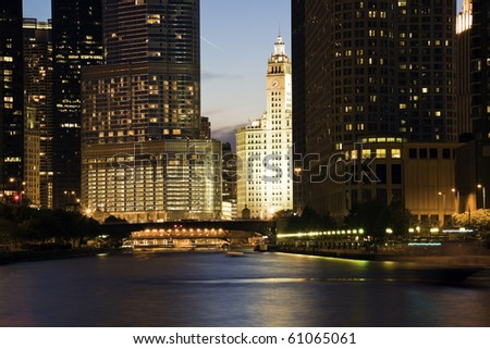 Wrigley Building surrounded by skyscrapers - Chicago, IL. - stock photo