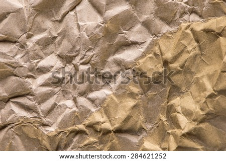 Wrinkled brown paper abstract background.