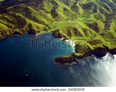 Wrinkled Green Appearance of Hills and Mountains along the coastline of Northland, New Zealand - stock photo
