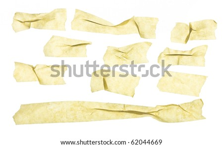 wrinkled grungy looking masking tape close up isolated on white - stock photo