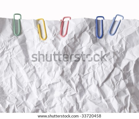 wrinkled paper with colorful paper clips - stock photo