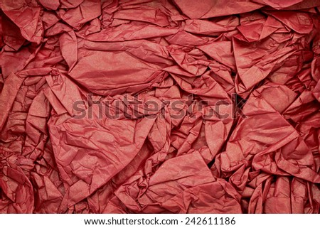 Wrinkled red paper as background - stock photo