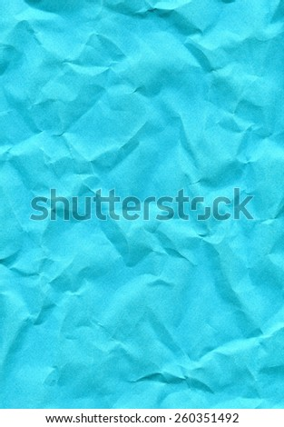 Wrinkled turquoise paper fragment as a background texture - stock photo