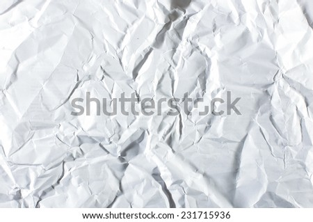 Wrinkled white blank sheet of paper - stock photo