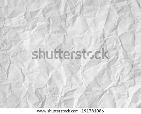 Wrinkled white paper textured background as a crumpled crushed sheet with a rough three dimensional surface as a design element document for copy space. - stock photo