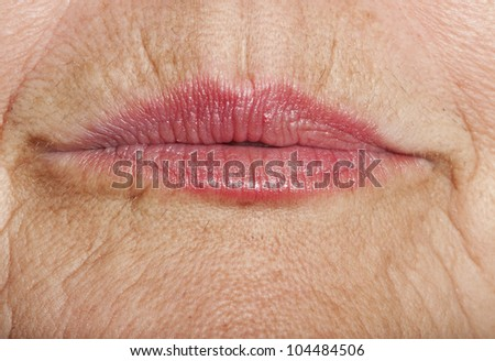 wrinkled woman skin with lips