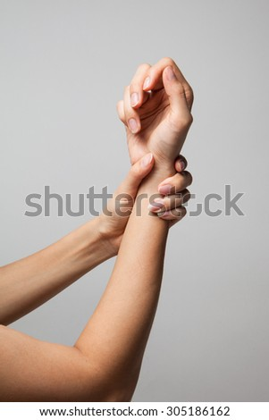 Wrist injury woman holds a hand on her pain wrist.Medical Concept - stock photo