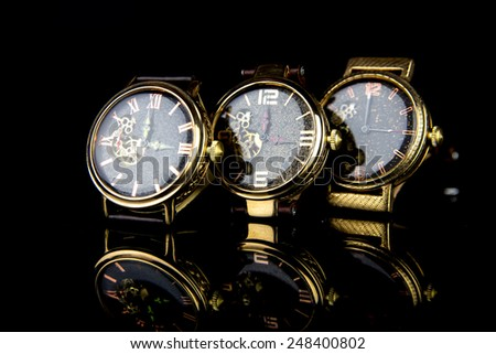 Wristwatch man on black background - stock photo