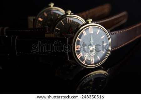 Wristwatch on black background - stock photo