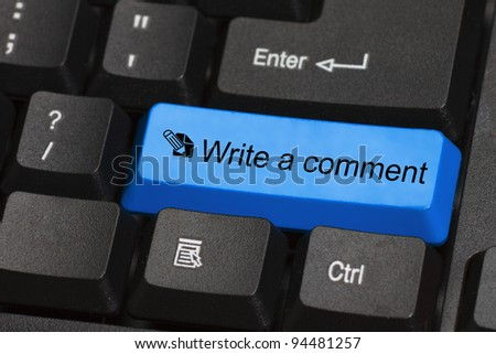 Write a comment word on blue and black keyboard button - stock photo