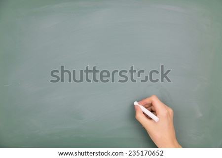 Write on the blackboard - stock photo