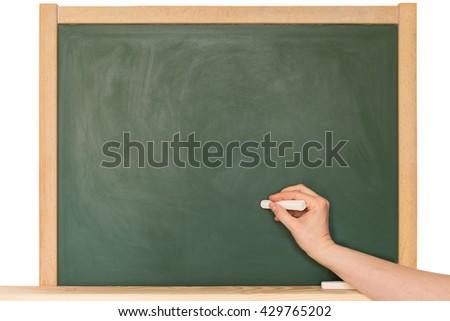 Write something on a blank blackboard - stock photo