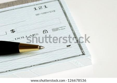 Write the dollar amount on the check - stock photo