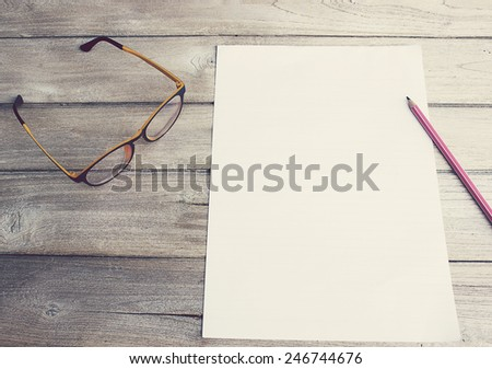 Write to the memories on paper, pencil and glasses - stock photo