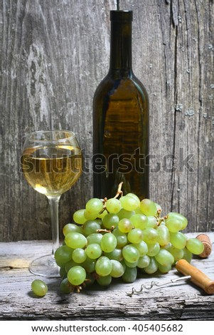 write wine bottle, grapes and a glass of wine - stock photo
