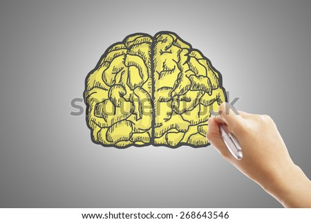 Write your brain and idea with hand - stock photo