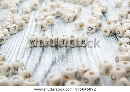 writer word written on wood block. wooden abc - stock photo