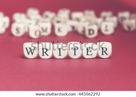 Writer word written on wood cube with red background - stock photo