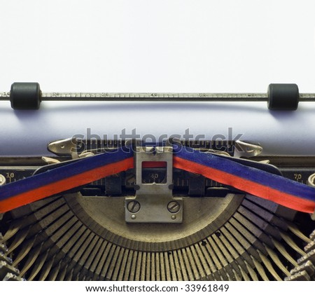 writers' block: vintage typewriter with blank paper; good copy-space in paper area - put your own message in a typewriter font - stock photo