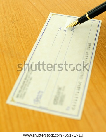 Writing a check using a fountain pen, focus on the nib - stock photo