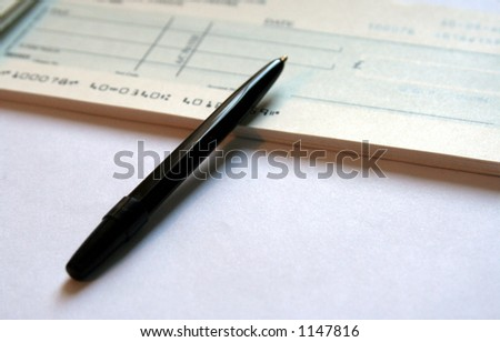 Writing a cheque - stock photo