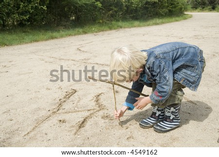 writing a letter in the sand - stock photo