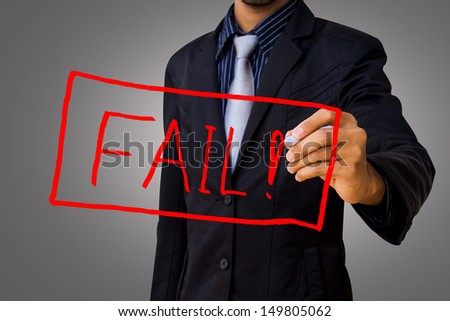 Writing a message that failed by businessman. - stock photo