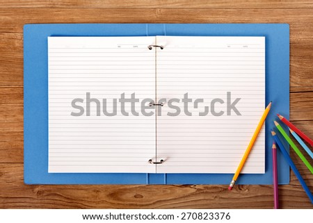 Writing book ring binder open, student desk, copy space - stock photo
