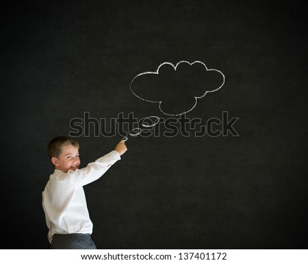 Writing boy dressed up as business man with thought thinking chalk cloud on blackboard background - stock photo