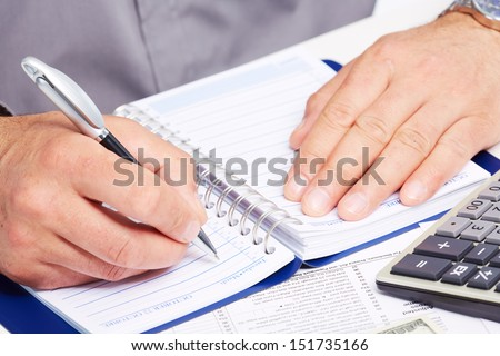 Writing businessman. Finance and accounting business background.