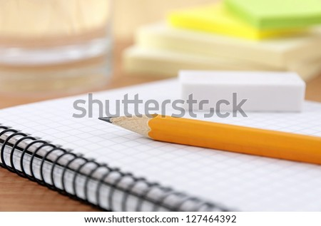 Writing equipment on desk - stock photo
