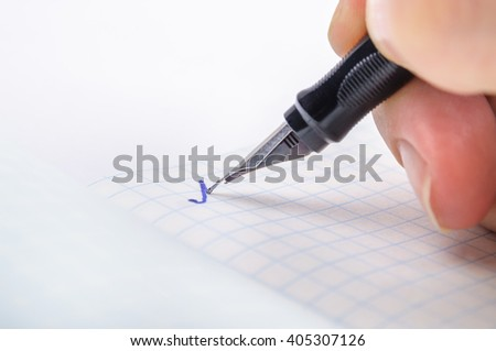 "Writing feather ink pen letter ""A"" in a notebook in a cage"