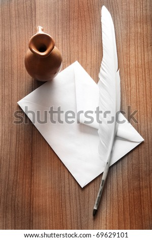 Writing feather on the background - stock photo