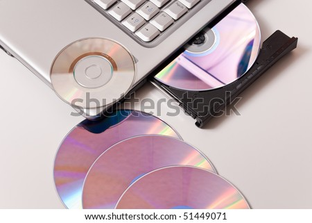 Writing Files on Blank CD's - stock photo