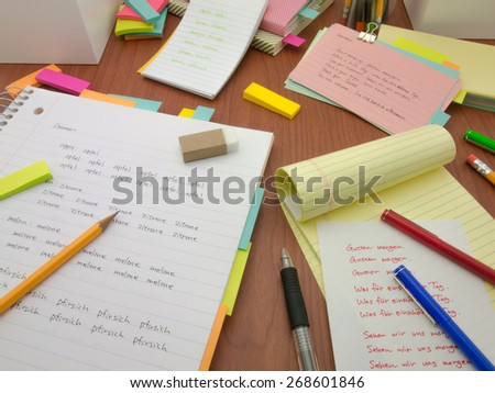 Writing new words again and again to learn new language. - stock photo