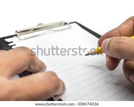 Writing on black clipboard, notepad, blank white notepad, notebook and paper clips isolated on a white background