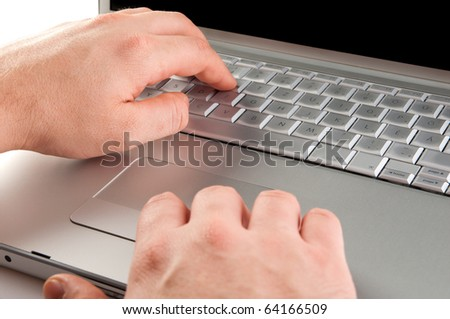 Writing on laptop with white background - stock photo