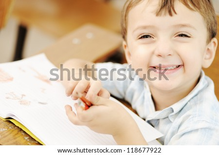 Writing schoolboy - stock photo