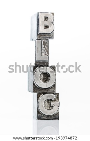"written the word ""blog"" with lead letters an old printing press - stock photo"