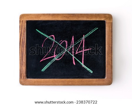 Written with chalk on a blackboard: year 2014 strikeout, crossed out, strikethrough, meaning that it has finished. - stock photo