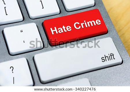 Written word Hate Crime on red keyboard button. Online Protection and Internet Security Concept. - stock photo