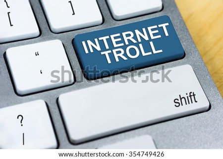 Written word Internet Troll on red keyboard button. Online Protection and Internet Security Concept. - stock photo