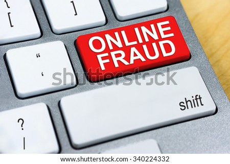 Written word Online Fraud on red keyboard button. Online Protection and Internet Security Concept. - stock photo