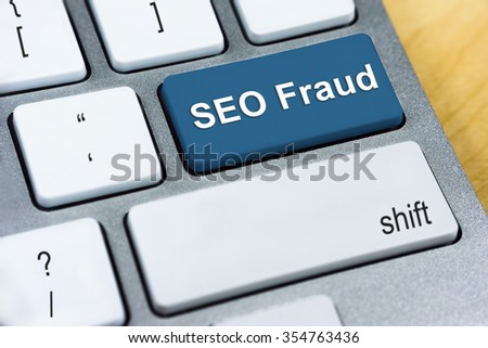Written word SEO Fraud on red keyboard button. Online Protection and Internet Security Concept. - stock photo