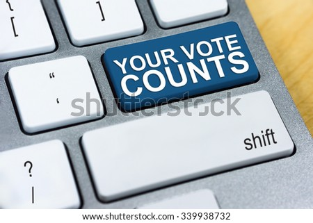 Written word Your Vote Counts on blue keyboard button
