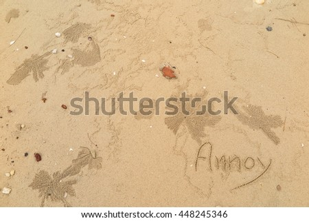 "written words ""Annoy"" on sand of beach"